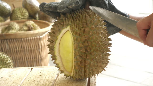 Vendor Peeling Durian With Knife, Chiang Mai, Thailand video