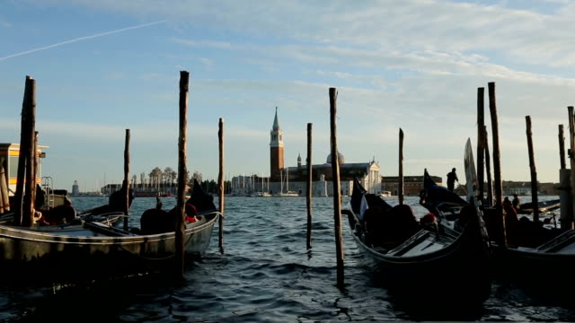 Venetian gondolas at sunset in Venice, Venezia, Italy, Europe video