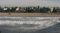 (HD1080i) Venice Beach Winter: Snow Capped Mountains behind Surfers video