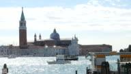 Venice Church of San Giorgio Maggiore in Venice, Italy with gondolas rocking on water video