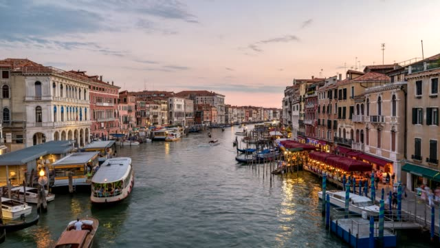 Venice city skyline day to night sunset timelapse from Rialto Bridge and Venice Grand Canal, Venice, Italy, 4K Time lapse video