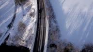 AERIAL, vertical: Cars driving along the road in winter video