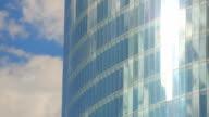 Vertical pan shot of modern glass building, windows of office video