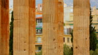 Vertical pan shot of tall marble columns, Corinthian capitals and architraves video