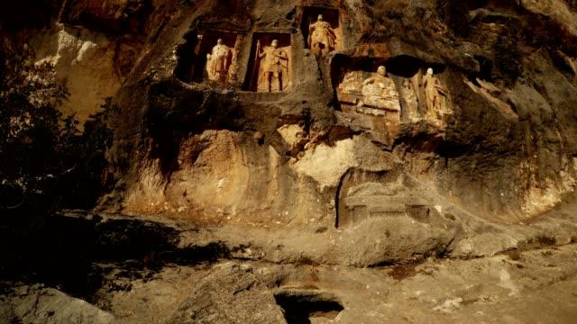 Vertical panorama The Man Rocks figures in niches Adamkayalar Mersin province Turkey video