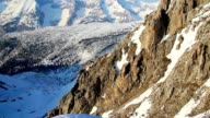 Vertical view of snowy mountain ridge with glacier on top video