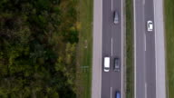AERIAL, vertical view: Traffic on freeway - both ways video