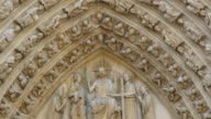 Very detailed scupted images on the wall of the cathedral video