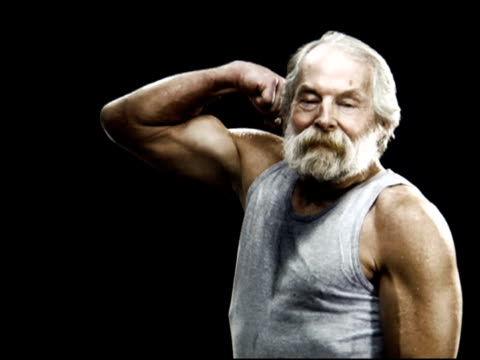 NTSC Very fit Senior citizen flexes Bicep and smiles video