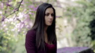 very sad girl in a park: depression, sadness, troubled, looking video
