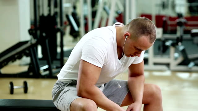 Very tired man in the gym video