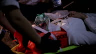 Victim of accident on stretcher video