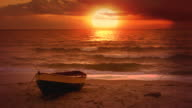 Video background. Lonely boat and beautiful sunset at the sea video