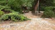 HD video Boulder flood waters cascades through homes video