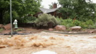 HD video Boulder flood waters past home video