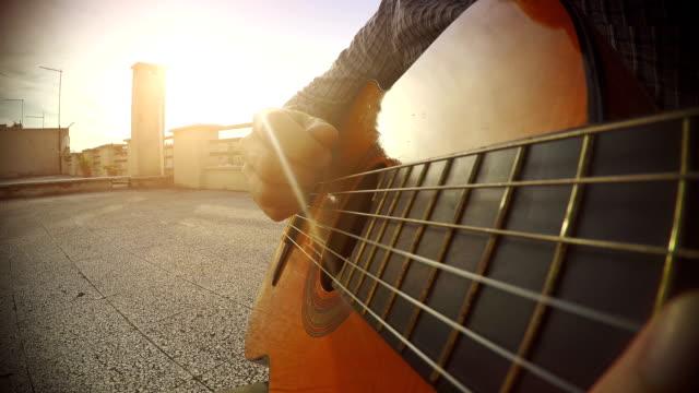 POV video: close-up man playing guitar video