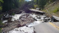 HD video Creek washes out road Boulder Colorado video