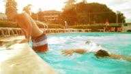 HD video friends dive into swimming pool edit video
