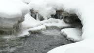 HD video heavy snow falls on icy Bear Creek waters Morrison Colorado video