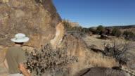 HD video hiker admires petroglyph panel Southeast Colorado video
