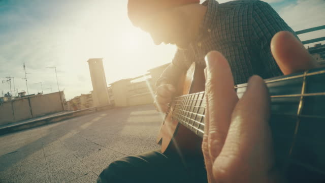 POV video: man playing guitar and singing video