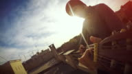 POV video: man playing guitar on the terrace video