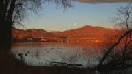 HD video moon sunrise on duck lake Rocky Mountains Colorado video