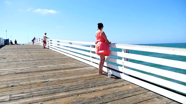 Video of a woman at the pier in California-slow motion video