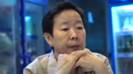 video of Asian senior woman sitting and wait in restaurant video