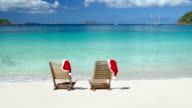 video of chairs with Santa hats at a tropical beach video