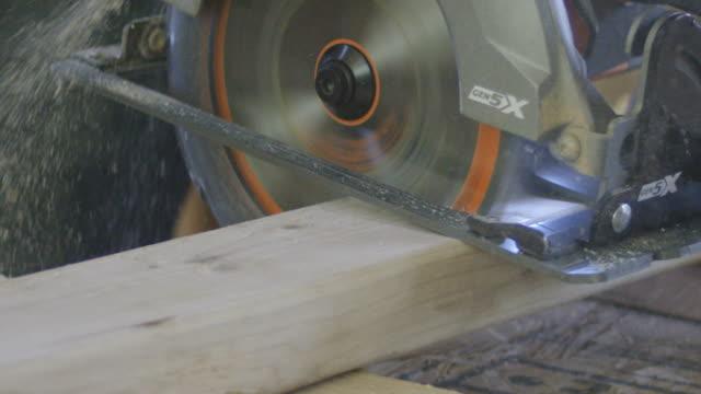 SLOW MOTION video of circular saw cutting through 2x4 video