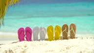 video of colorful sandals in sand on a Caribbean beach video
