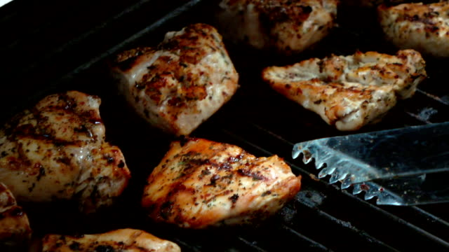 Video of cooking chicken on the grill-real slow motion video