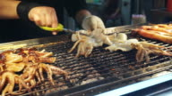 Video of flame grilled charcoal squid, Taiwan night market street food. video