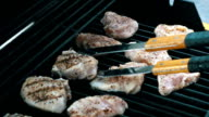 Video of flipping over poultry on the grill-real slow motion video