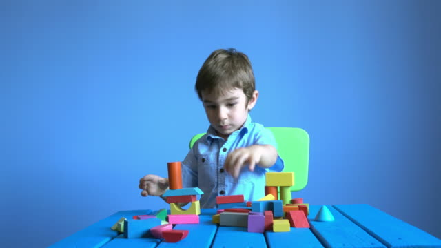 UHD Video Of Little Boy Playing With Multi colored Toys video
