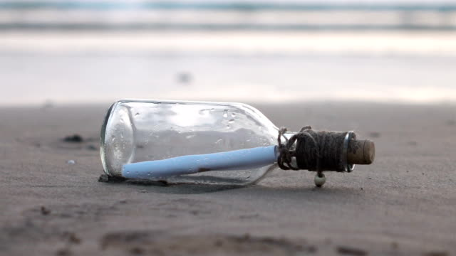 Video of message in the bottle on the beach-slow motion video