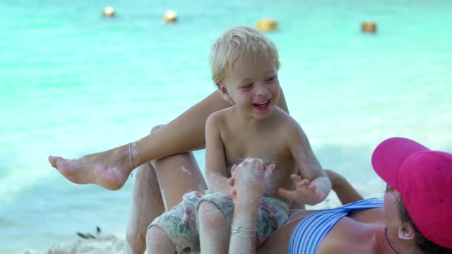 video of mother and son playing at the Caribbean beach video