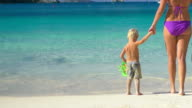 video of mother and son with snorkeling gear in Caribbean video