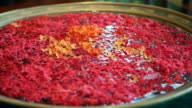 Video of red Ixora flower floating on water at spa resort wellness video