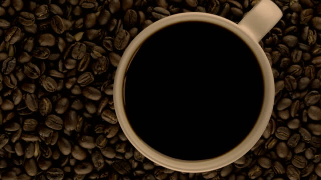 Video of Rotating Coffe Cup and Coffee Beans in 4K video