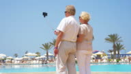 Video of senior couple taking a selfie picture in 4K video