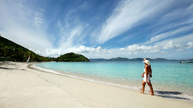 video of seniors walking the beach at Peter Island, BVI video