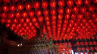 HD video of Thousand of Chinese red lanterns. Illuminate lamps to celebrate Chinese New Year. Beautiful night scene of temple in Taiwan video