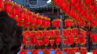 HD video of Thousand of Chinese red lanterns. Illuminate lamps to celebrate Chinese New Year. Beautiful night scene video