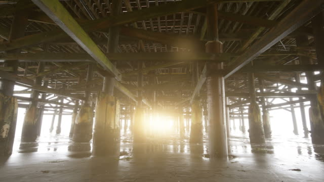 Video of walking under pier in 4K video