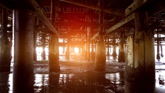 Video of walking under pier in real slow motion video