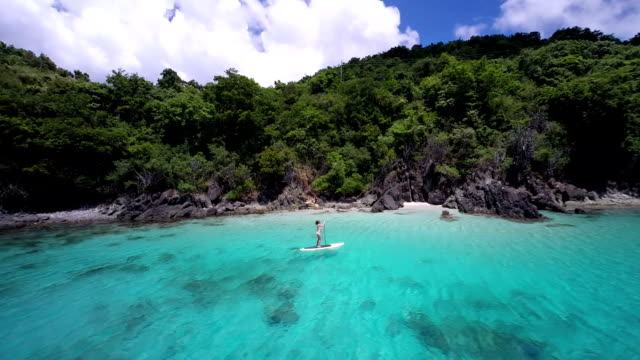 video of woman paddling on a paddle board in Caribbean video