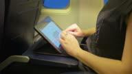 Video of woman using digital tablet in 4K video
