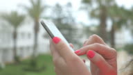 Video of woman using mobile phone in 4K video